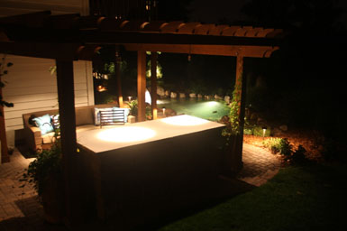 Image: Tier One Landscape pond, landscape, and outdoor room lighting.
