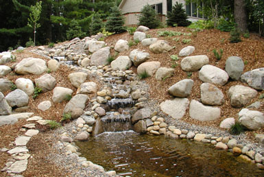 Image: Tier One Landscape boulder work.