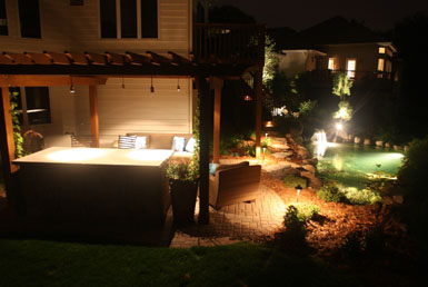Image: Tier One Landscape outdoor room, pond, and landscape lighting.