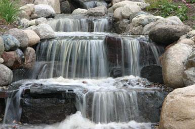Image: Tier One Landscape waterfall.