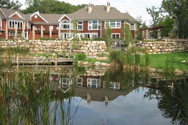 Pond with shoreline enhancement and boulder walls
